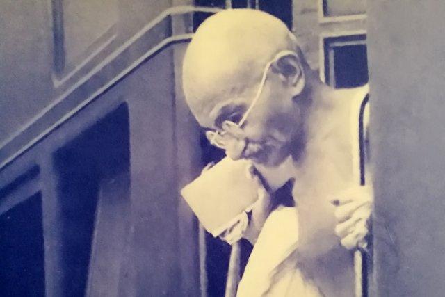 Gandhiji alighting from train