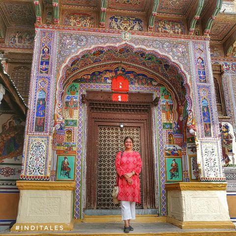 Shekhawati Haveli in the background with Anuradha Goyal