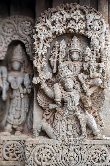 Garuda carrying Lakshmi & Narayana at Hoysala Temples