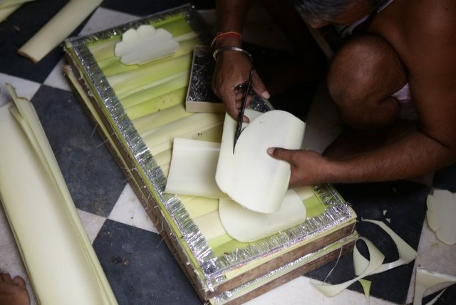 Cutting and making of design out of Banana bark