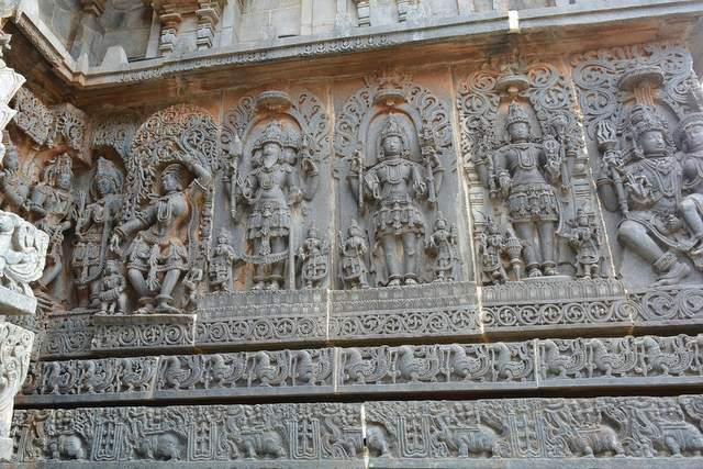 Stone carved sculptures on the walls of Hoysaleshwar temple