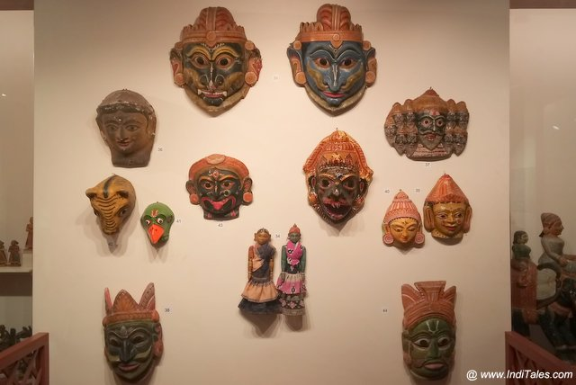 A display of carved painted wooden masks