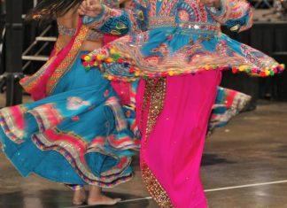 Traditionally dressed performers of Garba songs dance