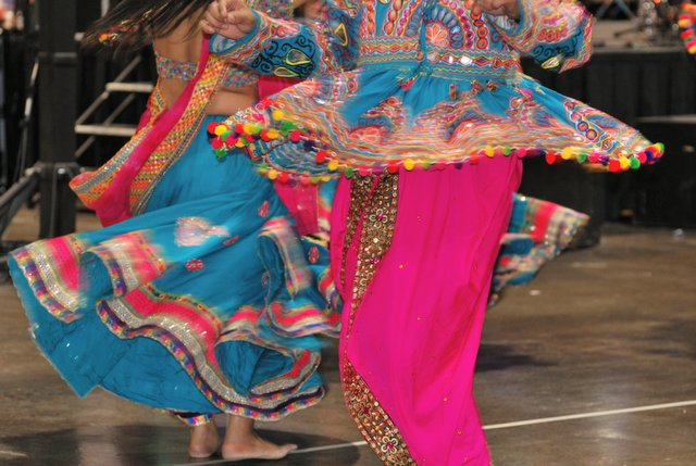 Traditionally dressed performers of Garba songs dance