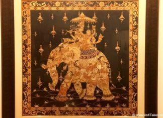 Radha Krishna riding on an intricatley painted Elephant