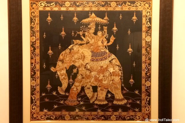 Radha Krishna riding on an intricately painted Elephant