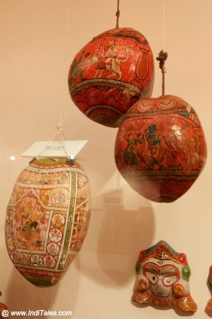 Traditionally painted whole coconuts