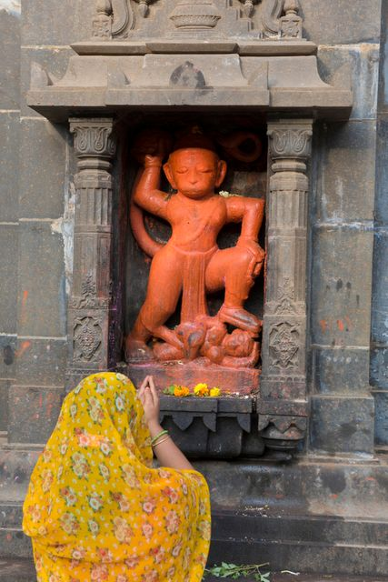 A devotee praying to the Hanuman on the premises