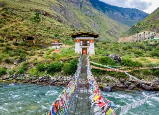 Iron chain bridge Tachogang Lhakhang over the Paro river - Bhutan History Heritage & Culture