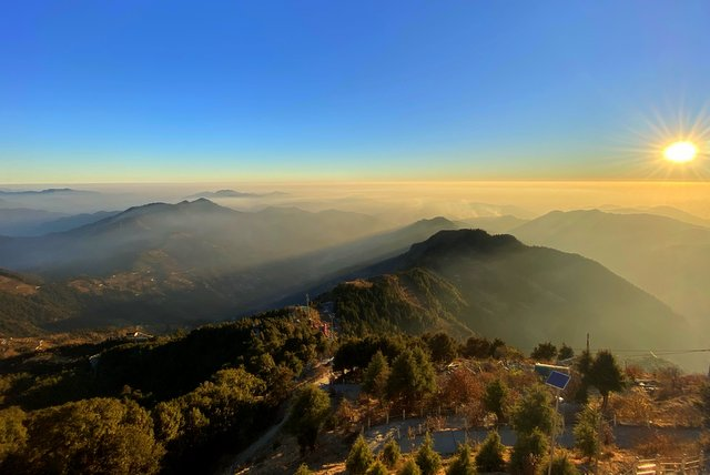 Natural views of hills from Surkanda Devi Temple at Sunset
